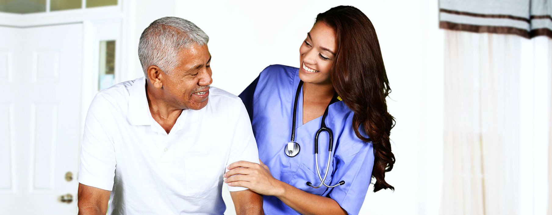 nurse and elderly man smiling smiling with each other