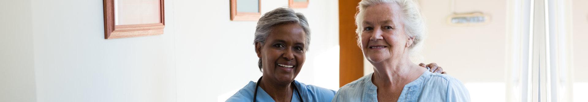nurse and elder woman smiling